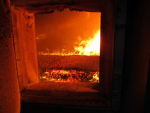 Fire the combustion of biomass in the form of pellets in the boi Stock Photo