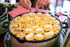 Fire cooking Burning for `mussels, shrimp, squid/octopus` in Takoyaki balls Stock Images