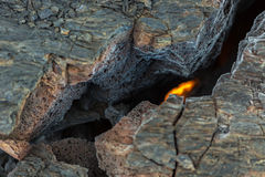 Fire at the crack of frozen lava field at Tolbachik volcano, after eruption in 2012, Klyuchevskaya Group of Volcanoes Stock Photography