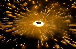 Fire cracker at night. A rotating fire cracker throwing bolts of light at diwali festival royalty free stock photography