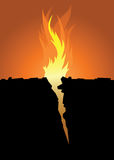 Fire Crevice. Flames emerge from a sharp crevice in the ground Stock Image