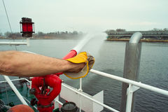 Fire crew on boat Royalty Free Stock Images