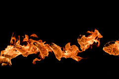 Fire curve. Orange fire flying through the black night royalty free stock images