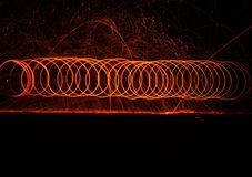 Fire cycloid. A steel wool fire cycloid by men for fire rings Royalty Free Stock Photos