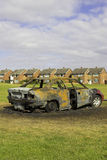 Fire Damaged Car. An urban scene showing a burnt out car on a U.K. housing estate stock image
