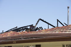 Fire damaged roof of house with chared timber beams Royalty Free Stock Photography