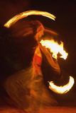 Fire dance. Fire-show, woman in action with fire Royalty Free Stock Photo