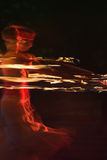 Fire dance. Fire-show, woman in action with fire Royalty Free Stock Photography