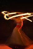 Fire dance. Fire-show, woman in action with fire Stock Image