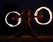 Fire Dance on the Beach at Night. Beautiful Fire Dance on the Beach at Night Royalty Free Stock Photo