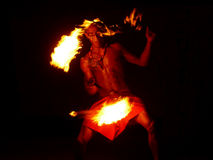 Fire dance man in Fiji. A Fijian man performs a traditional fire dance routine Royalty Free Stock Image