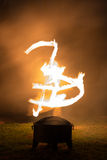 Fire Dance. Recreation of a Primitive Fire Dance.  This fun shot captures what might have been some sort of ancient symbol from the days of the original fire Royalty Free Stock Photography