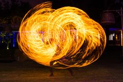 Fire Dance Show. A performance of fire dance on a beach in the dark night royalty free stock images