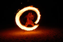 Fire Dancer. Long exposure of a Tahitian fire dancer during a Polynesian wedding ceremony Stock Photos