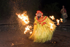 Fire dancer. A dance which is a form of the Kathakali called Theyyan performed in the past to keep tigers away from the villages at night Royalty Free Stock Photography