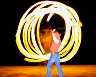 Fire dancer. Demonstrates her skills Royalty Free Stock Photo