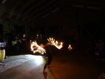 Fire Dancer Alexis Aaron spins fire around her body as people wa Royalty Free Stock Photo