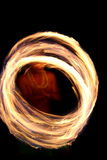Fire dancer circles. A hawaii native dances with fire in the night time with motion blur Royalty Free Stock Images