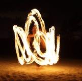 Fire Dancer in the dark stock photos