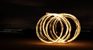Fire Dancer in the dark Stock Photos