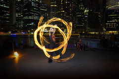 Fire Dancer with Fire Poi Royalty Free Stock Photography