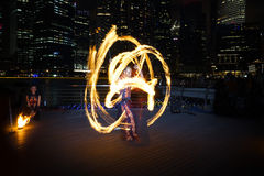 Fire Dancer with Fire Staff Stock Images