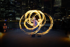Fire Dancer with Fire Staff Royalty Free Stock Photography