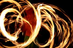 Fire dancer in Hawaii. A hawaii native dancer with fire in the night time with motion blur Royalty Free Stock Images