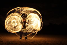 Fire Dancer In The Dark Stock Photography
