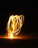 Fire dancer at night Stock Photography