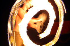 Fire dancer at night in a camp Stock Images