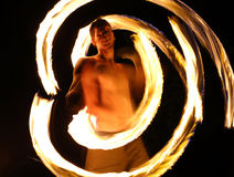 Fire dancer at night in a camp Royalty Free Stock Photos
