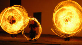 Fire Dancers. Image taken at the Cape Town Castle of a group of fire dancers, on of there containers accidently broke appart Royalty Free Stock Image
