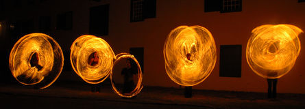 Fire Dancers. Image taken at the Cape Town Castle of a group of fire dancers, on of there containers accidently broke appart Royalty Free Stock Photo