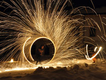 Fire dancers. Men with special torches performing on their night show Royalty Free Stock Photo