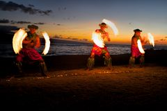 Fire Dancers at Dusk on the Beach Royalty Free Stock Photos