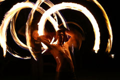Fire dancers at night in a camp Stock Image