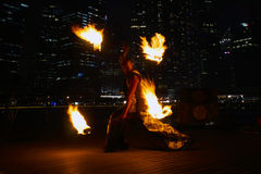 Fire Dancers. SINGAPORE - MAR 9: Fire Dancers street performance at Marina Bay on Mar 9, 2014 in Singapore Royalty Free Stock Image