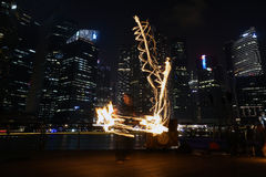 Fire Dancers. SINGAPORE - MAR 9: Fire Dancers street performance at Marina Bay on Mar 9, 2014 in Singapore Royalty Free Stock Photography