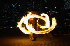 Fire Dancers. SINGAPORE - MAR 9: Fire Dancers street performance at Marina Bay on Mar 9, 2014 in Singapore Stock Photography