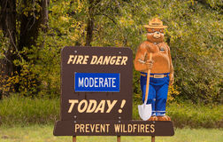 Fire Danger Moderate Today Smokey the Bear Sign. Mascot for the forests against fire Smokey the Bear reports the danger level today Royalty Free Stock Photo