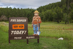Fire danger sign. Smokey the bear, fire danger sign in Custer, South Dakota Stock Photos