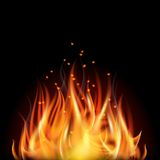 Fire on dark background. Royalty Free Stock Photos