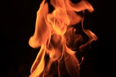 Fire in the dark abstract background stock images