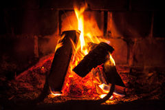 Fire in dark fireplace Stock Photos