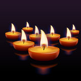 Fire in dark 04-11. Illustration of few lighting candles with reflections on dark background Royalty Free Stock Image