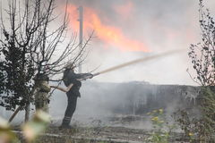 Fire department in action during burning warehouses with plastic products. KHMELNITSKY, UKRAINE - OCTOBER 11: fire department in action during burning warehouses royalty free stock photography