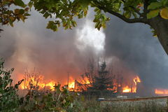 Fire department in action during burning warehouses with plastic products. KHMELNITSKY, UKRAINE - OCTOBER 11: fire department in action during burning warehouses stock photo