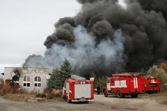 Fire department in action during burning warehouses with plastic products. KHMELNITSKY, UKRAINE - OCTOBER 11: fire department in action during burning warehouses stock images