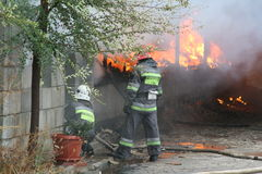 Fire department in action during burning warehouses with plastic products. KHMELNITSKY, UKRAINE - OCTOBER 11: fire department in action during burning warehouses royalty free stock images